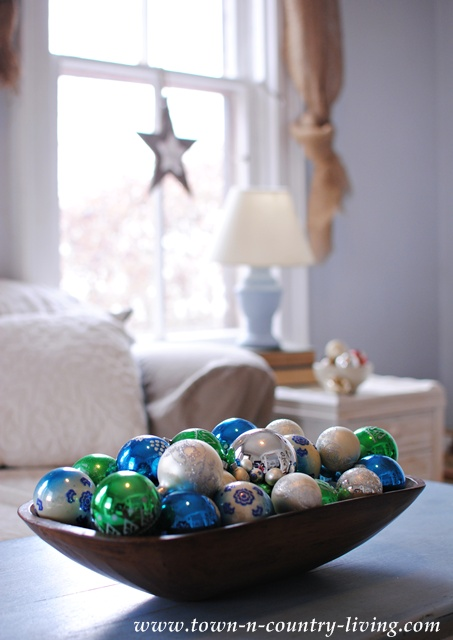 DIY Christmas Vignette. A simple wooden bowl filled with vintage glass ornaments.