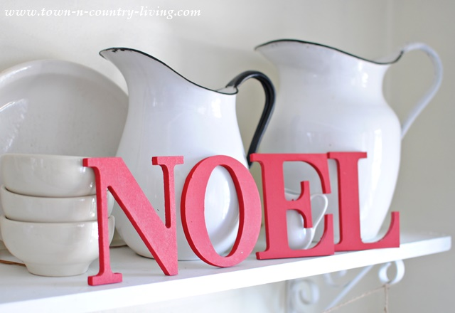 Wooden letters painted red spell NOEL. One of many simple Christmas decorating ideas.