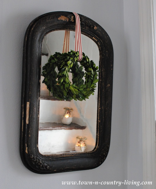 Vintage black mirror with boxwood wreath. Simple Christmas decor and a collection of holiday vignettes.