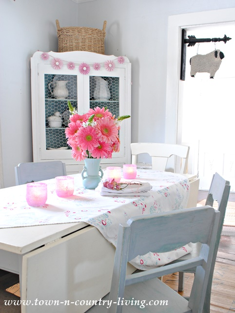 Pink Gerbera Daisies create a whimsical centerpiece in my farmhouse dining room