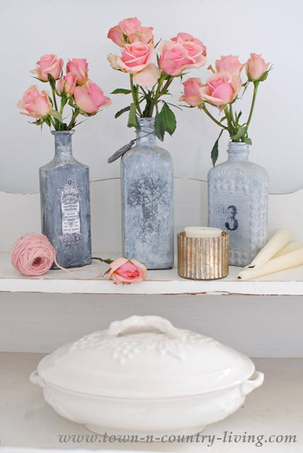 Spray Roses pair with gray bottles and white ironstone