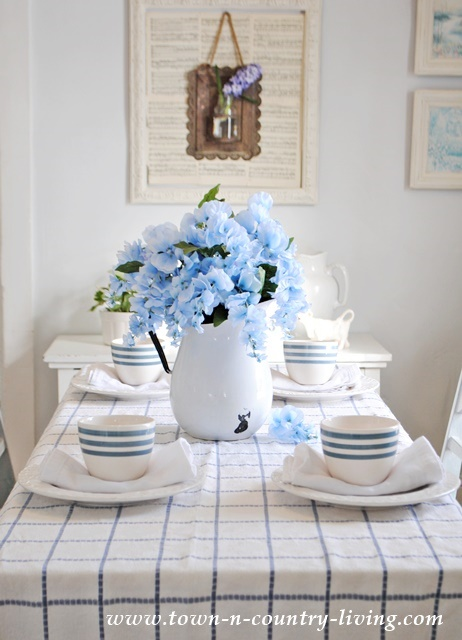 Spring Dining Room in Blue and White. The vintage tablecloth was the inspiration .