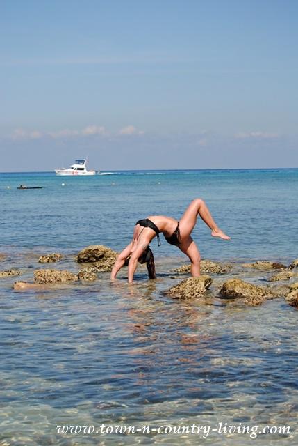 Bridget doing yoga on the beach at Cozumel