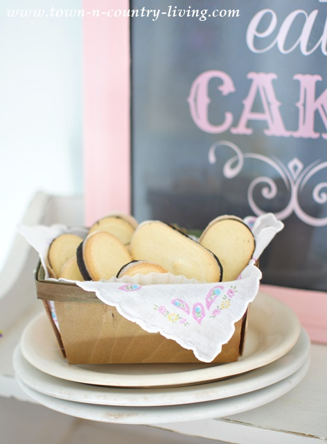 Old fruit box gets lined with a vintage hankie. Perfect for serving dainty cookies at an afternoon tea.
