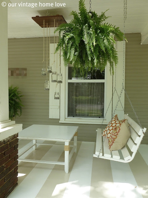 Front Porch Swing with a creative mason jar light fixture
