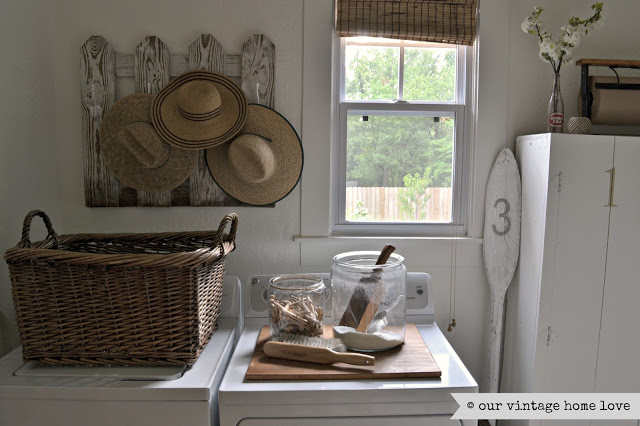 Laundry room in a 1905 farmhouse. See the rest of this charming home tour!
