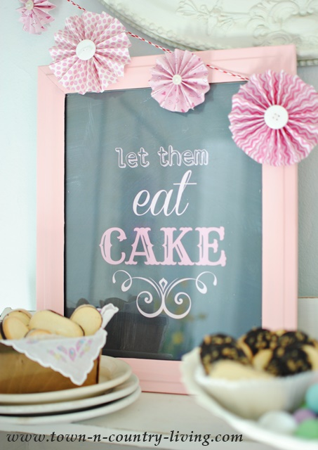 "Old Frame is painted and turned into ""Let them eat cake"" sign for a dessert bar."