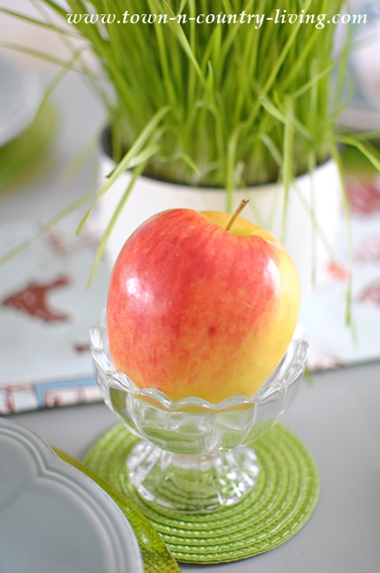 Apples in Ice Cream Dishes at a Spring Table Setting
