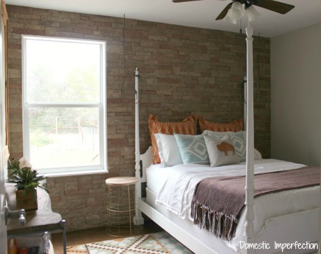 Guest Bedroom with Stone Wall