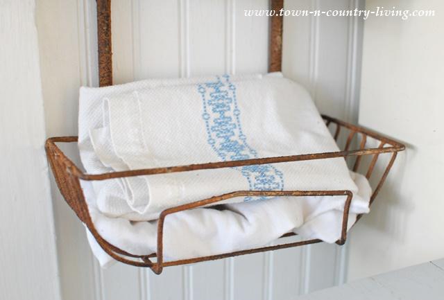 Vintage kitchen towels in wall basket hanger