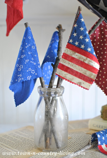 DIY Mini Flags made with sticks and swatches of fabric