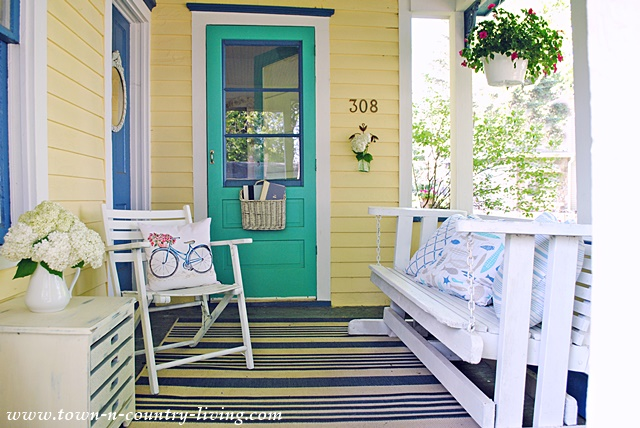 Simple farmhouse porch town country living for Farmhouse porch swing