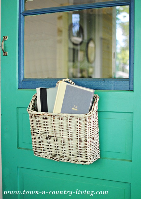 Basket of Books on the Front Door