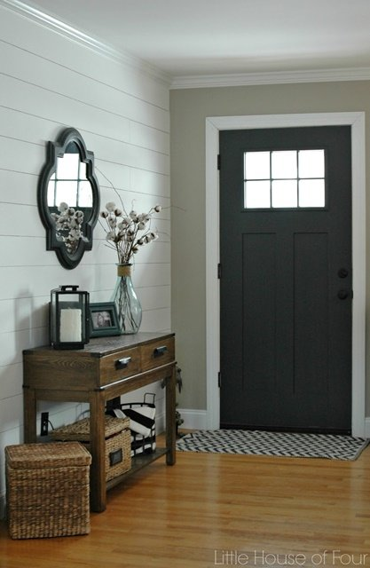 Entryway with planked walls and painted door