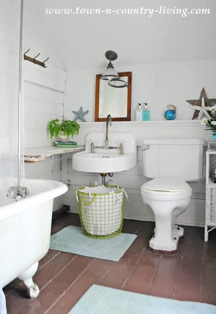 Farmhouse bathroom with claw foot tub