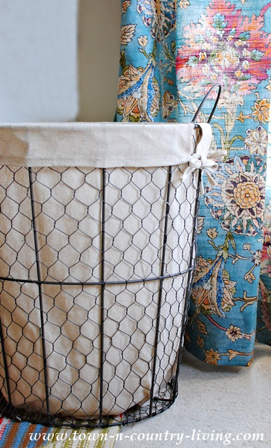 Fabric Lined Wire Basket. Perfect for Storing Items.