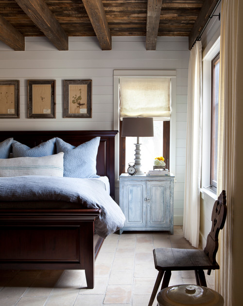 13 ways shiplap adds charm to any room town country living for Farmhouse style bed