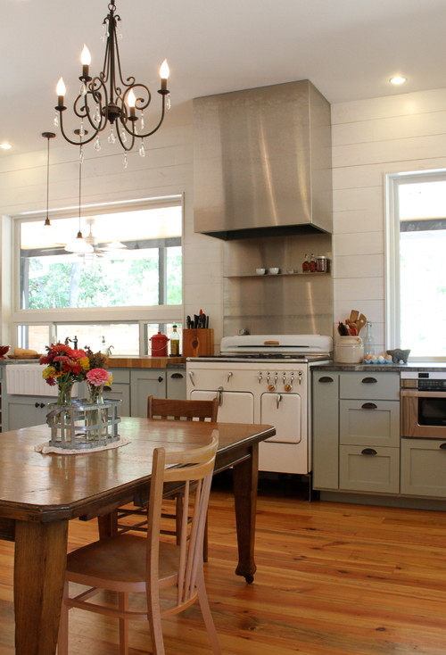 13 ways shiplap adds charm to any room town country living for Farmhouse kitchen design pictures