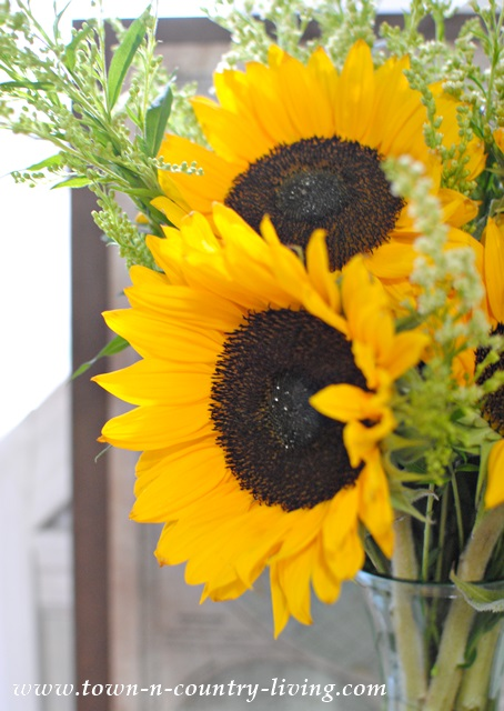 Simple Sunflowers. Tuck a Single Stem in a Wine Bottle.