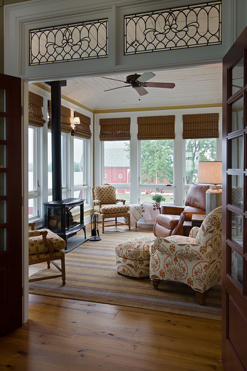 11 pretty sunrooms to love town country living for Farmhouse sunroom ideas