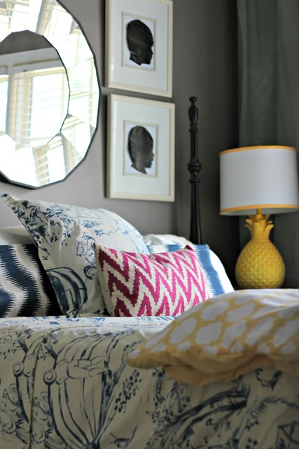 Guest Room with Bright Colored Pillows and Lamps