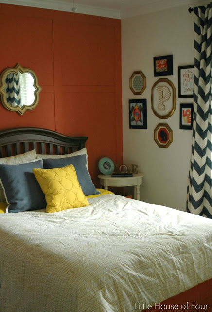 Orange Statement Wall in a Cozy Bedroom