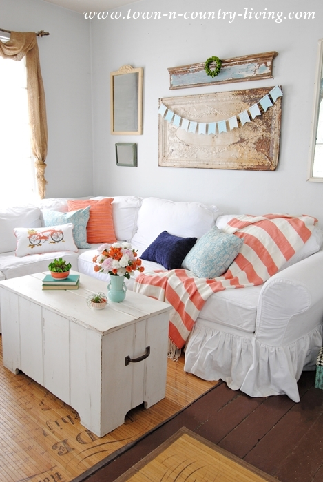 Spring Home Tour. White Sectional with Pillows in Coral, Navy, and Aqua.