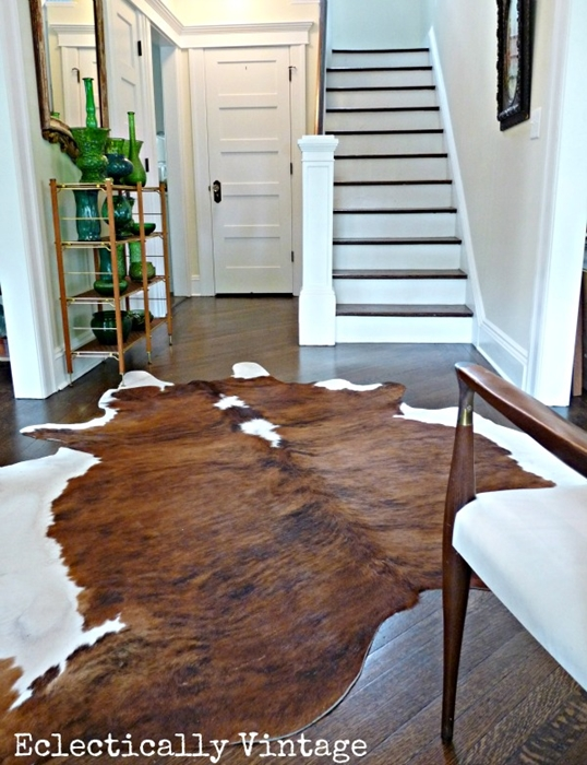 Foyer with Two-Tone Staircase and Cowhide Rug