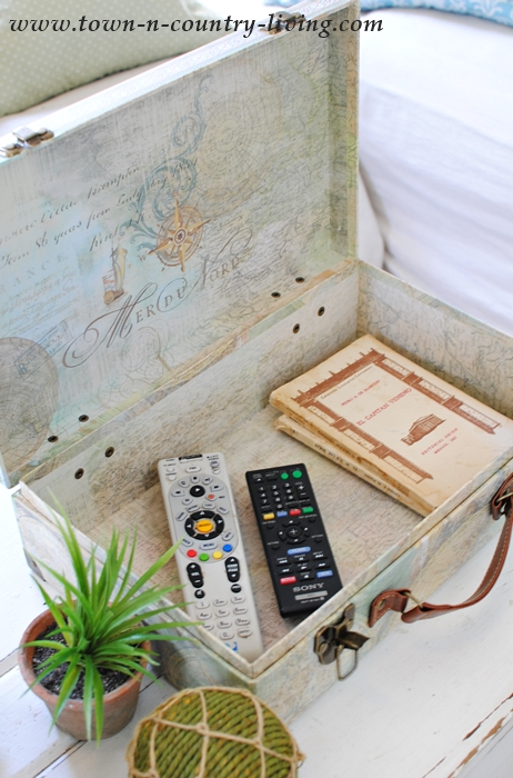 Small Cardboard Suitcase Hides Remote Controls