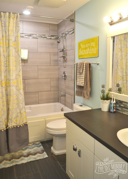 The diy mommy charming home tour town country living for Bathroom decor yellow and gray