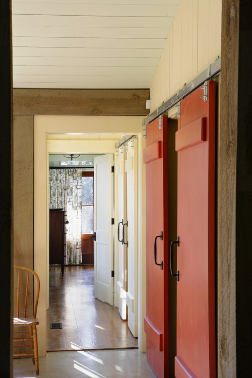 Red Sliding Barn Doors in Rustic Hallway