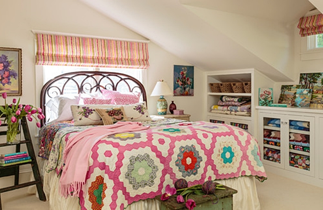 Colorful Quilt on Iron Bed
