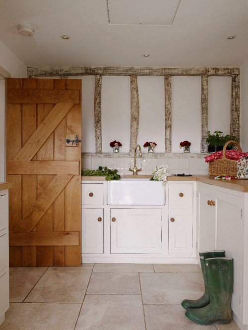 Barn doors farmhouse style ideas town country living for Country laundry room