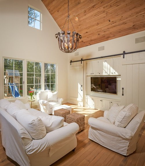 Shabby Chic Living Room with Sliding Barn Doors for TV