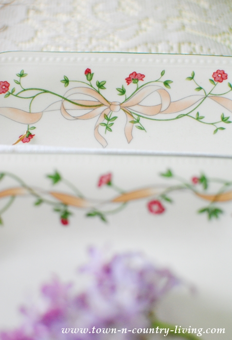Ribbon and Floral Detailing on Pink and Green Dishes