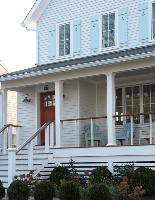 Farmhouse Porch with Adirondack Chairs