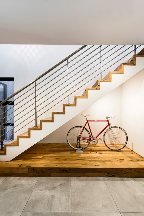Store a bicycle under a staircase