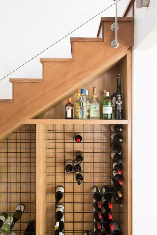 Storage Under Staircases. A wine cellar? Why not?