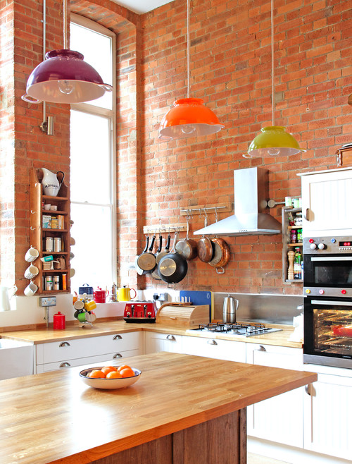 Eclectic Kitchen with Exposed Brick Walls