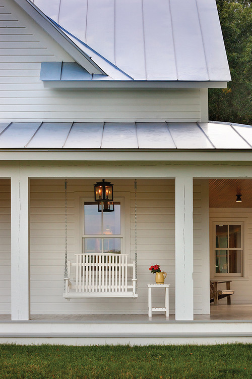 Farmhouse porch summer living at its best town for Farmhouse metal roof