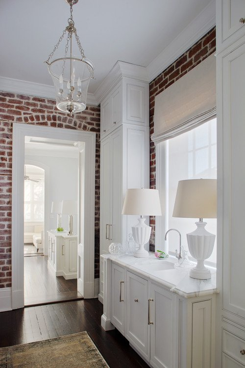 Exposed Brick Walls And White Painted Woodwork