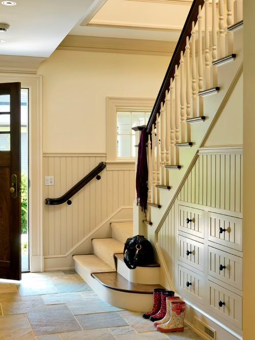 Traditional Entry with Storage Under Staircases