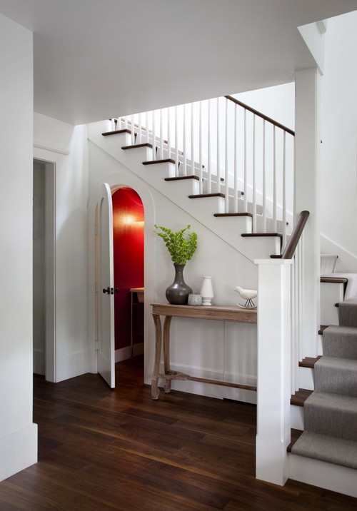 Staircase with Powder Room Tucked Below