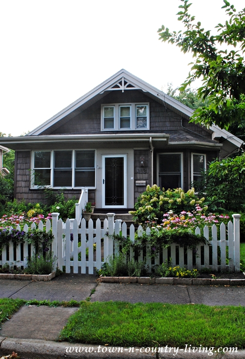 Cottage Bungalow with White Picket Fence