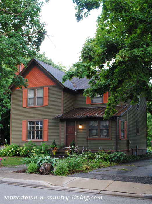 Green and Orange Clapboard Home