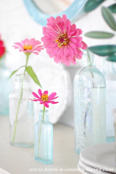 Pink Zinnias in Vintage Aqua Bottles
