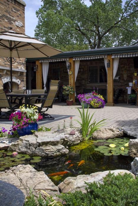 Cabana and Backyard Pond Create an Outdoor Oasis