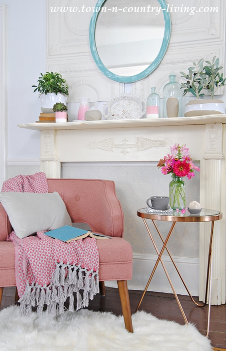 Create a cozy reading nook with a cute little chair and elegant side table