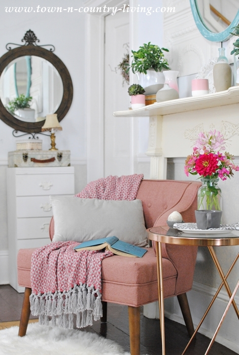 Cozy Reading Corner with Pink Chair and Gold Metal Table