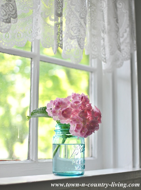 Lace Valance in a Farmhouse Kitchen Window